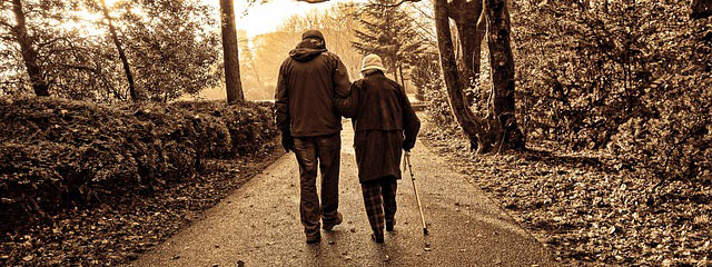 Photo of an elderly couple walking together.