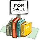 Image of books with a for sale sign.