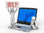Image of a help sign next to a computer.