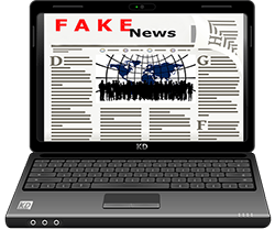 Image of a laptop with fake news on the screen.