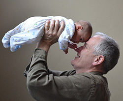 Image of a grandfather holding a baby.