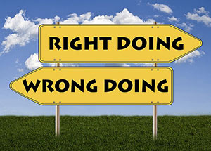 Image of two signs pointing in opposite directions, one says right oing and the other says wrong doing.