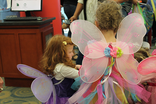 Photo of children wearing fairy wings.