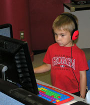 A boy playing on the computer.