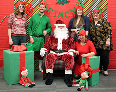 Photo of the children's area staff with Santa Claus.