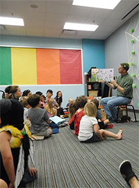 Photo of Mr. Evan reading to children.