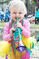 Image of a child in Mardi Gras beads.