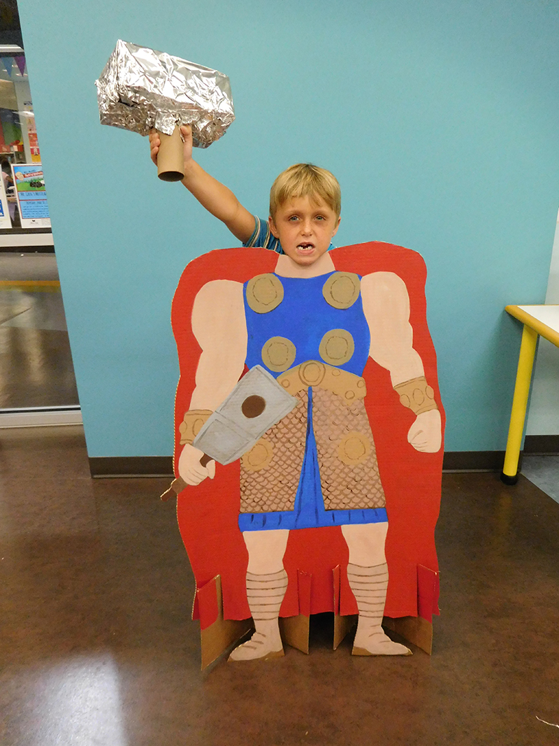 Photo of a boy holding Thor's hammer!