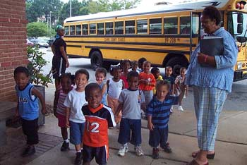 Children arrive from a local school to attend a library program.