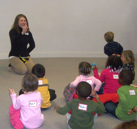 A photo of children listening to storytime at the library.